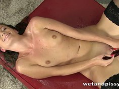 Gorgeous self pee from stocking wearing Naty Lee