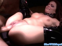 Busty redhead riding in her hooker boots