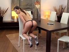Candice Luca sits on the stool with her legs spread wide