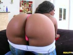 A curvy black lady pleasures a white boy