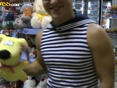 Cutie kneels and plays with two big stiff dicks