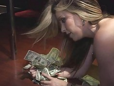 Big tittied blonde strips and fucks in the club for money
