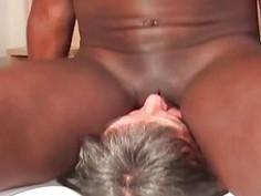 Elderly white man worships a black woman