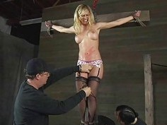 Bound up girl acquires tongue and facial torture