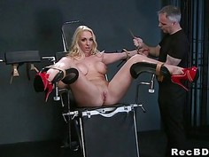 Fake big tits blonde sub zippered in gyno chair