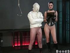 Slave in straitjacket gets handjob to orgasm