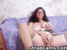 Busty granny with curly hair masturbating on webcam