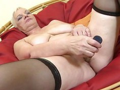 Busty granny undressing and playing with her tits