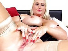 Blonde mature lady masturbating