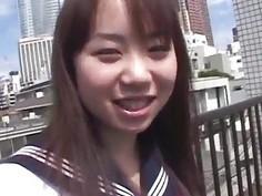 Asian teen poses outdoors before masturbating