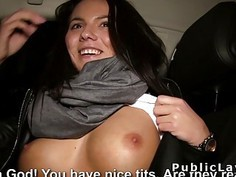Euro babe flashing big tits in the car