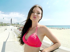 Sasha Rose in a stunning red bikini poses outdoor