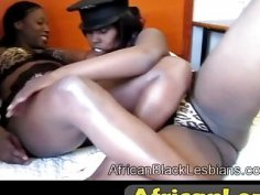 African lesbos using dildo to please in bedroom