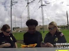 Cock hungry female cops take a huge dick of a black felon and blows it