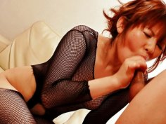 Reina Sakai  in black fishnets with her horny guy sucking his dick until he erupts a geyser of...