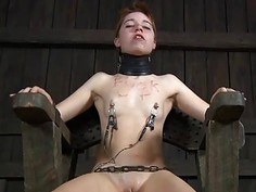 Caged cutie gets a whipping for her smooth gazoo