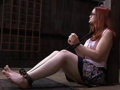 Gagged cutie with clamped nipples gets enjoyment