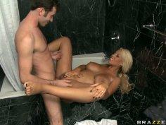 Devilish blonde wench Bridgette B gets banged hard in a bathroom