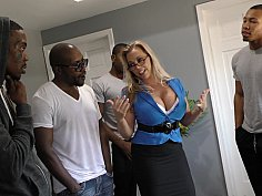 Nerdy blonde and a bunch of black guys