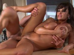 Bootylicious milf Lisa Ann rides cock on the kitchen counter