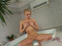 Curvy blonde seductress Jo having fun with blue dildo