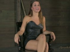 Being attached to the wooden bar Mia Gold has to know what BDSM is