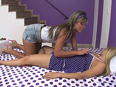 Blonde lesbians scissoring on a bed
