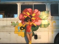 Japanese cutie Rika Sato paints a bus wearing nothing but sexy lingerie