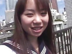Asian teen poses outdoors before masturbating