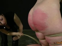 Plump brunette Caroline Pierce gets tied up and treated in BDSM way